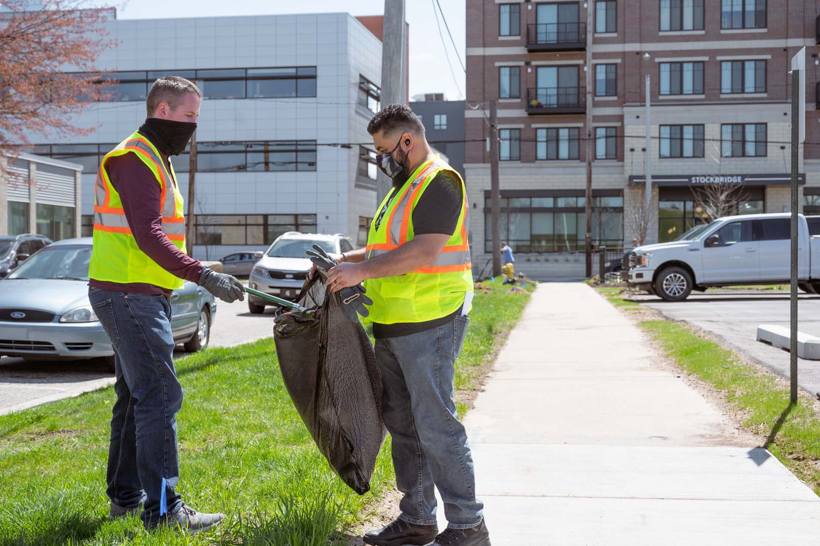 Rockford team members volunteer to clean up portions of the West Side for Earth Day 2021.